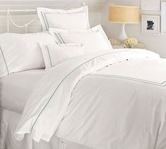 Duvet cover and shams; white with blue accents (shams $29, duvet cover $129)