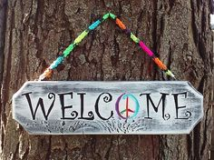 Shabby Chic Welcome sign....Peace!  12x4x.5 indoor/outdoor sign with knitted multi colored hangernitted by GeoDesignDecor on Etsy