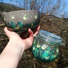 Which one do you prefer?✨ Glass jar or ceramic cup✨ . . . handpainted, handcrafted, handmade gifts, etsy, etsy seller. etsy love, glass jar, glass painting, cereal cup, ceramic cup, ceramics, best gift ideas, planting, fireflies, firefly art, nature art, plants painting, illustration, starry night, night scene, galaxy insects, jam lover, marmelade Painting Glass Jars, Plant Painting, Firefly Art, Hand Painted Mugs, Galaxy Painting, Nature Illustration, Moon Art, Ceramic Cups, Best Gifts