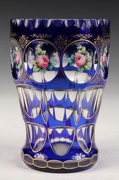 """ART GLASS VASE - Bohemian Cobalt Cut to Clear Vase with enameled rose blossoms in top rank of bull's-eyes, gilt detailing. 7"""" tall"""