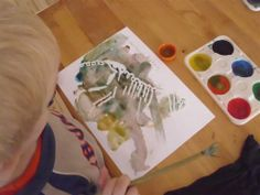 we could trace dino-skeletons in white wax crayons on paper and get kids to discover with watercolours