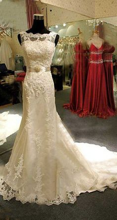 What a stunning dress - beautiful lace detailing, sumptuous train and waist detailing.