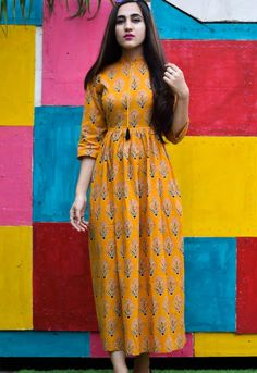Yellow tassel floral garden maxi is part of Frock style kurti - While contemplating the refined quality of this teal dress, you cast your doubts aside and dive right into its lovely look! Stylish Dress Designs, Stylish Dresses, Frock Fashion, Fashion Dresses, Frock Style Kurti, Kalamkari Dresses, Long Gown Dress, Kurta Designs Women, Blouse Designs