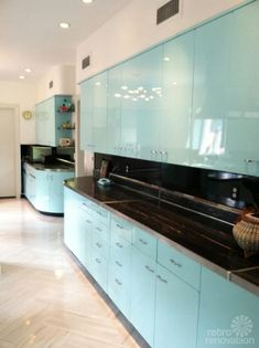 """Beautifully refurbished vintage metal kitchen cabinets, repainted with PPG auto paint. The flooring is Armstrong's Striations line in the """"atmosphere"""" color. Via: Retro Renovation Metal Kitchen Cabinets, Painting Kitchen Cabinets, Kitchen Paint, Kitchen Flooring, New Kitchen, Vintage Kitchen, Blue Cabinets, Kitchen Countertops, Turquoise Kitchen Cabinets"""