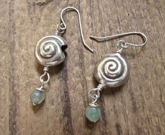 ♥ 10% of animal or sea creature amulet designs donated to animal rescue and rehab ♥   Beach chic earrings! .925 hill tribe silver seashell and fluorite wire worked with sterling silver ear wires. Feel the ocean breeze?  These handmade beach inspired artisan earrings measure just under 2 inches from top of ear wires.