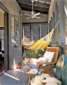 Hammock This porch was made for relaxation. Louvered shutters keep the midday sun at bay while overhead fans get the air circulating. A wicker chair with plush cushions and a Brazilian hammock provide unbeatable lounge spots. Style At Home, Living Pool, Outdoor Living, Louvered Shutters, Outdoor Hammock, Camping Hammock, Diy Camping, Patio Hammock Ideas, Hammock Balcony