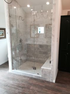 Frameless shower with a door, fixed panel, fixed notched panel, glass to glass hinges, Chrome hardware finish, and Colonial handle.