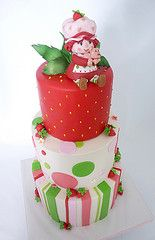Strawberry Shortcake cake, bottom two tiers iced in buttercream and top tier covered in fondant. Gumpaste character