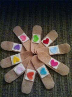 felt bandaids, inspired by Doc Mcstuffins. I used a real bandaid as a pattern. All was put together with a glue gun. The back has a white square in the middle and a piece of velcro glued on one side. I found an old, little first aid kid to store them in for her doctors bag. Super easy and my daughter loves them!