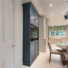 The TV Cabinet is hand painted in Stiffkey Blue from Farrow & Ball. Tv In Kitchen, Blue Kitchen Cabinets, Kitchen Cabinet Colors, Kitchen Interior, Kitchen Ideas, Kitchen Doors, Kitchen Inspiration, Oval Room Blue, Dining Room Blue