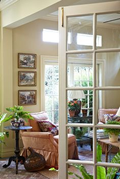 A brick floor and large windows help to bring the feel of the outdoors into this sunroom - Traditional Home® / Photo: Werner Straube / Design: Anna & Alan Clark