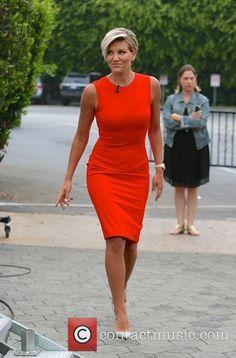 Love her dress and haircut.