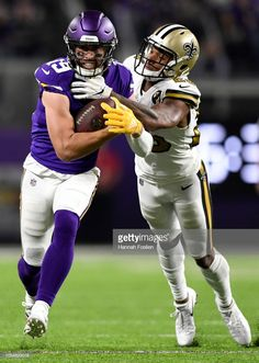 Adam Thielen of the Minnesota Vikings is tackled with the ball by. 4984475df