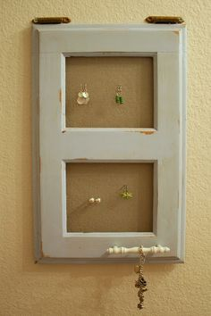 jewelry holder made from a cabinet door and window screening