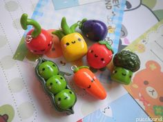 Polymer clay charms; that carrot and those peas are adorable.