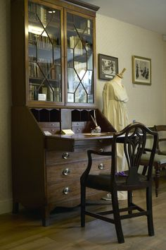 Inside Jane Austen's House in Chawton near Alton, East Hampshire. Pictured is Jane's father's bookcase which resided in Steventon Rectory as well.
