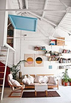 Slanted White Wood Plank Ceiling, Offset Bookshelves, Ladder to Secret Loft with Open Wall // indoor treehouse