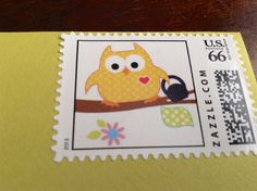 Closeup of custom stamp Andrew designed with the owl using his kettle bell. Crossfit baby shower