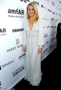 Stunning in silver: Gwyneth Paltrow in a Ralph&Russo dress with #HarryWinston earrings leads the stars on the amFAR red carpet as they honor Ryan Murphy at American Horror Story themed nightin Los Angeles on October 29, 2015
