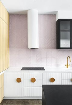 Create a soft, feminine look with a whole wall in pale pink tiles. Extending the splashback to fill the entire wall creates a focal point that transforms the overall look and feel of the space   Photography: Emily Bartlett   Story: Inside Out