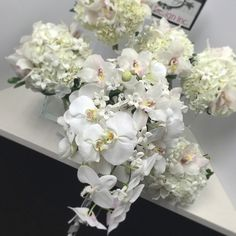Gorgeous bridal bouquet, phalaenopsis orchids and stephanotis. Bridal package