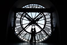 Musée d'Orsay engagement photos are incredibly rare since everything really needs to come together ... the right couple who is ok to invest into a few photos that take time to capture, wear dark attire, connect beautifully in silhouette, are willing to show up at the entrance right when the museum opens ... and, of course, be lucky to get a bright blue sky for perfect silhouette results.