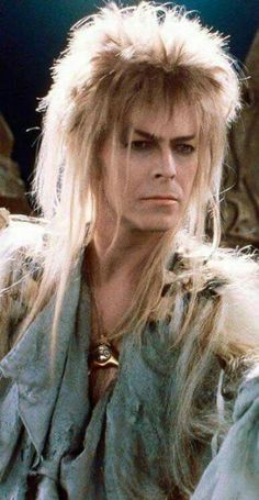 1986 - David Bowie as Jareth, The Goblin King in Labyrinth. I'll paint you mornings of gold. I'll spin you Valentine evenings. Though we're strangers 'til now, We're choosing the path Between the stars. I'll leave my love Between the stars. David Bowie Labyrinth, Labyrinth 1986, Labyrinth Movie, Jareth Labyrinth, Goblin King Labyrinth, King David, David Bowie Goblin King, The Thin White Duke, Ziggy Stardust