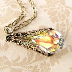 Make an entrance with this amazing and dynamic Swarovski Crystal Necklace. Precision facets create stunning elegance that is truly unforgettable. The picture truly does not do it justice :)  NOTE: The clasp in the pictures have been discontinued. Instead, I use now a very nice toggle clasp as shown in this necklace: https://www.etsy.com/listing/82940450/clear-crystal-necklace-ice-clear-aurora  - Top Quality Antique Gold Brass components, all nickel and lead safe - hypoallergenic! (beautiful…