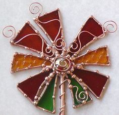 Desert Fancy Flower -- a funky piece of functional art created especially for those that are looking for something exciting and different. This is an original, one-of-a-kind sculpture that was created especially for your garden. This piece is created from gorgeous stained glass. I've jazzed it up with decorative soldering and funky copper wire frills. I've twisted the copper wire around the stake and finished it off with a glass bead.