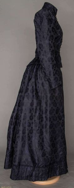 navy brocade bustle day dress, late 1880s...2-piece ribbed silk w/ floral brocade, puff sleeves, self fabric pleated hem flounce