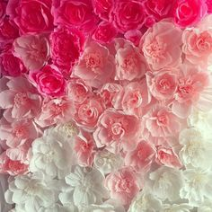 wedding paper flowers. Make a wall for one side of the reception room for pictures. Love it.