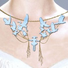 amazing necklace with girl holding stings attached to birds