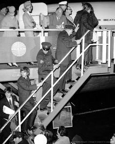 FEBRUARY 21, 1964: The Beatles leave for London from Kennedy Airport after three turbulent weeks in this country. More than 5,000 teenage beatlemaniacs bid their heroes goodby.