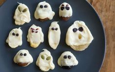 White Chocolate Ghosts by wholefoodsmarket: White chocolate over dried fruit and sunflower seeds. #Treats #Halloween #Ghosts #GF