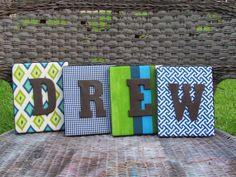 letter blocks on fabric covered canvas