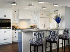 blue ikat chairs, white kitchen