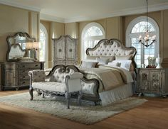 Elegant style with romantic designs and ornate detailing. The Arabella Bedroom Collection has distinct style with details that make a statement. With many options to complete your bedroom, Arabella brings great function and design. The collection is constructed from pecan veneers and select solids with a rustic aged finish. Rosette carvings, detailed moldings, framed drawers and reeded pilasters give each piece a unique, sophisticated look.