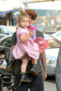 Heading to the playground in New York with dad David in 2013. See all of Harper Beckham's cutest looks.