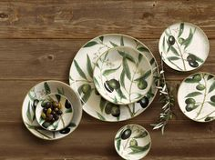 Our painted olive branch dinnerware collection inspired by Mediterranean olive groves.