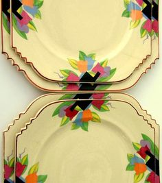 Art Deco Dinner plates in the 1920s Sienna Ware shape, Deco Tulip pattern by Crescent China - with  Modernistic tulip decals in retro Miami Beach colors: fuschia pink, periwinkle blue, & golden butterscotch amidst yellow and green leaves with black & lavender zigzags | Etsy