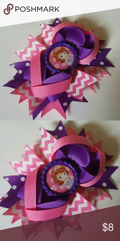 Sofia the First Hairbow Brand new. 4.5 inches.  Pink and purple chevron hairbow comes on an alligator clip.   Bundle and save!  Spend  $50 before shipping and get a FREE gift! Accessories Hair Accessories