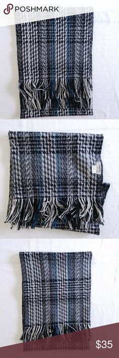 Shandon Ireland plaid wool scarf Shandon Ireland plaid wool scarf.  Black, white, gray, and blue plaid pattern.  100% woven wool with fringe.  Length is 63 in, fringe is 3 in, width is 11.75 in Shandon Accessories Scarves