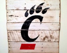 University of Cincinnati Wall Hanging by PalletsandPaint on Etsy Cincinnati Bearcats, University Of Cincinnati, House Essentials, Paint And Sip, Christmas Crafts For Gifts, Diy Bottle, Rustic Signs, Grad Parties, Dorm Decorations
