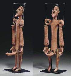 A Greek Terracotta Ithyphallic Marionette of Ten Articulated Pieces.