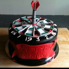 Dart board cake - cool.. If I had one though, I would hope they put all the numbers in lol