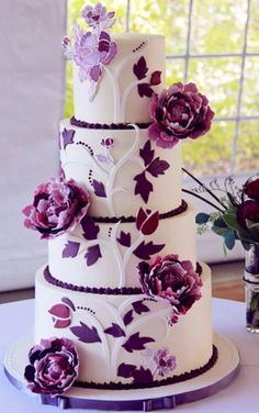 Gorgeous purple  white wedding cake design.