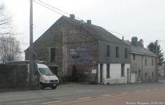 Une vieille pub SPA MONOPOLE bien effacer dans le sud de Belgique, près de la frontière française.