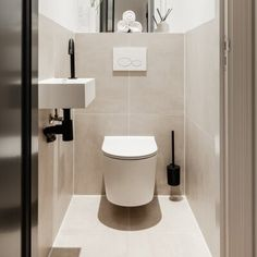 Minimalist Toilets, Minimalist Small Bathrooms, Small Downstairs Toilet, Small Toilet Room, Beige Bathroom, Bathroom Spa, Bathroom Design Small, Bathroom Interior Design, Townhouse Interior