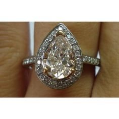 Pink diamond ring | pink halo diamond engagement rings | Pink pear diamond found on Polyvore