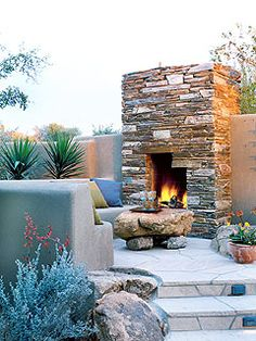 Fireplace sitting area in the yard.
